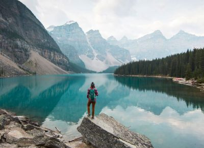 Female hiker standing over lake